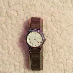 Vintage Timex wrist watch with green band